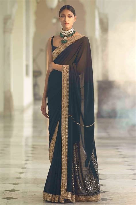 Black saree with textured blouse by Sabyasachi