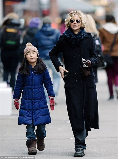 Meg Ryan bundles up for brisk stroll with gorgeous eight